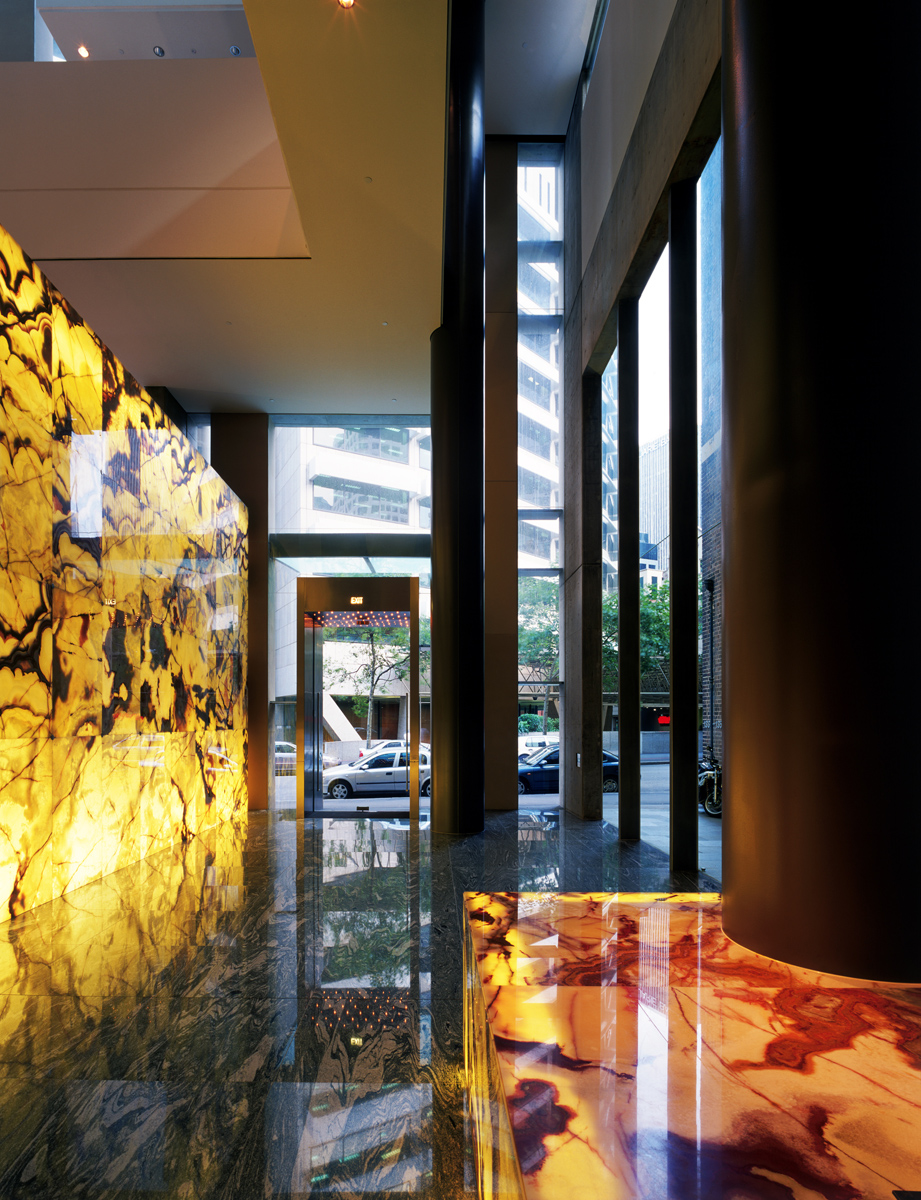 Entrance With Onyx Wall And Concierge Desk