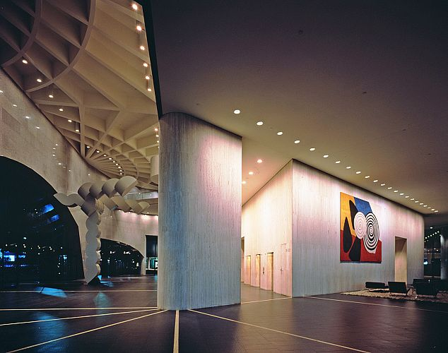 The entrance lobby with exposed structure and artworks by Carlberg and Calder